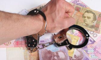 наручники, гроші, рука